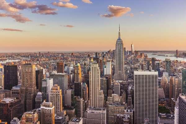 Manhattan skyline, New York skyline, Empire State Building, sunset, New York City, United States of America, North America Cost-burdened middle-class households