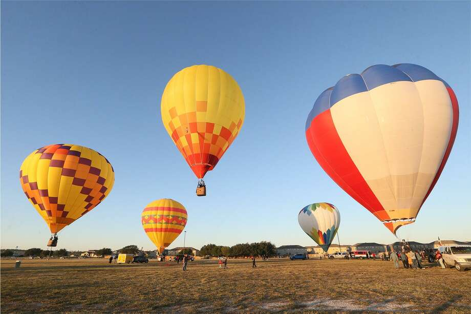 Hot air balloons take off in the Hare and Hound chase in the Balloonist competition during the Skylight Balloon Fest on the River City Community Church Grounds, 16765 Lookout Road in Selma, on Sunday, Oct. 29, 2017. Photo: Marvin Pfeiffer / San Antonio Express-News / Express-News 2017