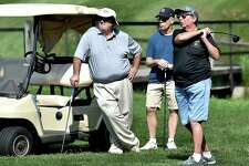 Allen Misinonile, of Shelton and coach, at left watches Earla Lanier drive at the adaptive golf program sponsored by Gaylord Hospital's Sports Association Programs, Wednesday, August 15, 2018, at Sleeping Giant Golf Course in Hamden.