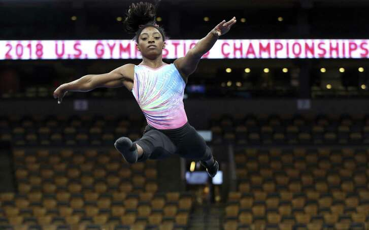 Simone Biles practices on the floor Wednesday in preparation for the women's national competition that begins Friday.