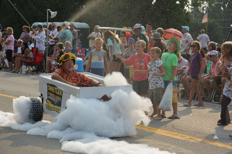 These are scenes from Wednesday's Parade of Fools Parade in Caseville, as part of the city's annual Cheeseburger Festival.