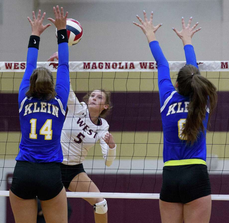 Magnolia West's Peyton Carlyle (5) goes up against Klein's Baylee Laskoskie (14) and Kalee Cadwell (6) during the first set of a non-district volleyball match at Magnolia West High School on Wednesday, Aug. 15, 2018, in Magnolia Photo: Jason Fochtman, Staff Photographer / Staff Photographer / © 2018 Houston Chronicle