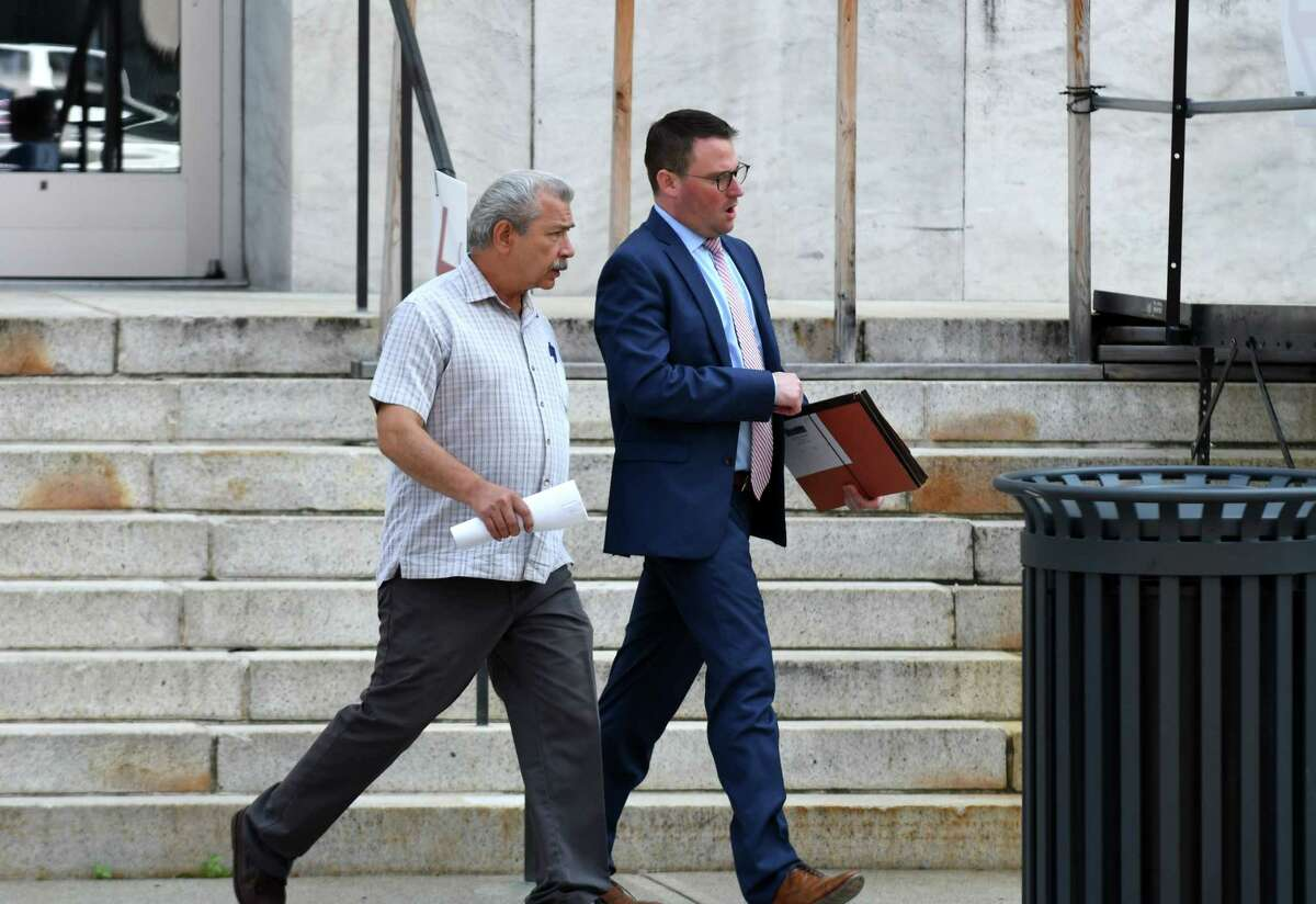 Longtime Halfmoon Planning Board member Thomas A. Ruchlicki, left, leaves U.S. District Court with his attorney, Samuel Breslin, right, after pleading guilty to lying to FBI agents about his business dealings with Halfmoon developer Bruce Tanski on Wednesday, Aug. 15, 2018, in Albany, N.Y. (Will Waldron/Times Union)