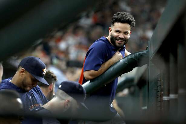 Houston Astros Jose Altuve (27) in the dugout during the fifth inning of an MLB game at Minute Maid Park, Wedneaday, August 15, 2018, in Houston.