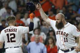 Houston Astros Evan Gattis celebrates his second home run of the night with Max Stassi (12) during the fifth inning of an MLB game at Minute Maid Park, Wedneaday, August 15, 2018, in Houston.