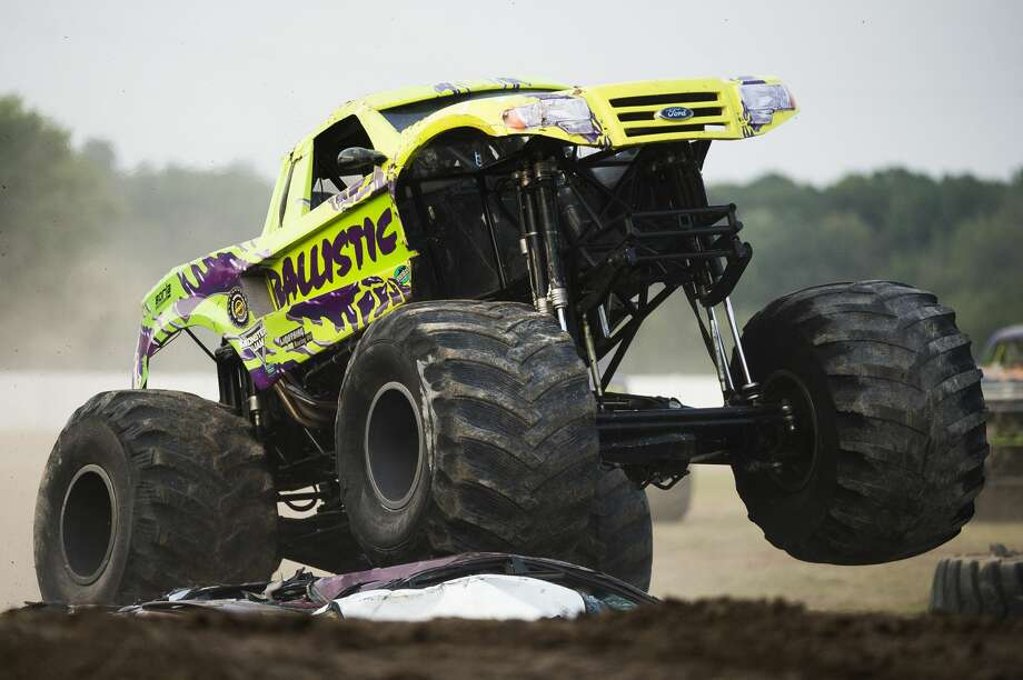 Mac Plecker of Georgia becomes airborne while racing his monster truck, Ballistic, during a monster truck rally on Wednesday, August 15, 2018 at the Midland County Fairgrounds. (Katy Kildee/kkildee@mdn.net) Photo: (Katy Kildee/kkildee@mdn.net)