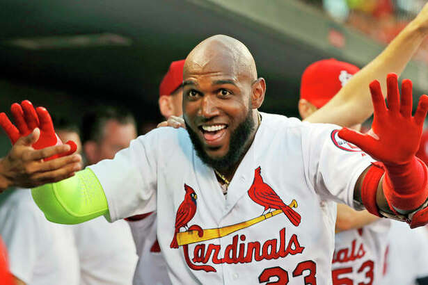 The Cardinals' Marcell Ozuna is congratulated by teammates after hitting a solo home run in the second inning of Wednesday night's game against the Washington Nationals in St. Louis.