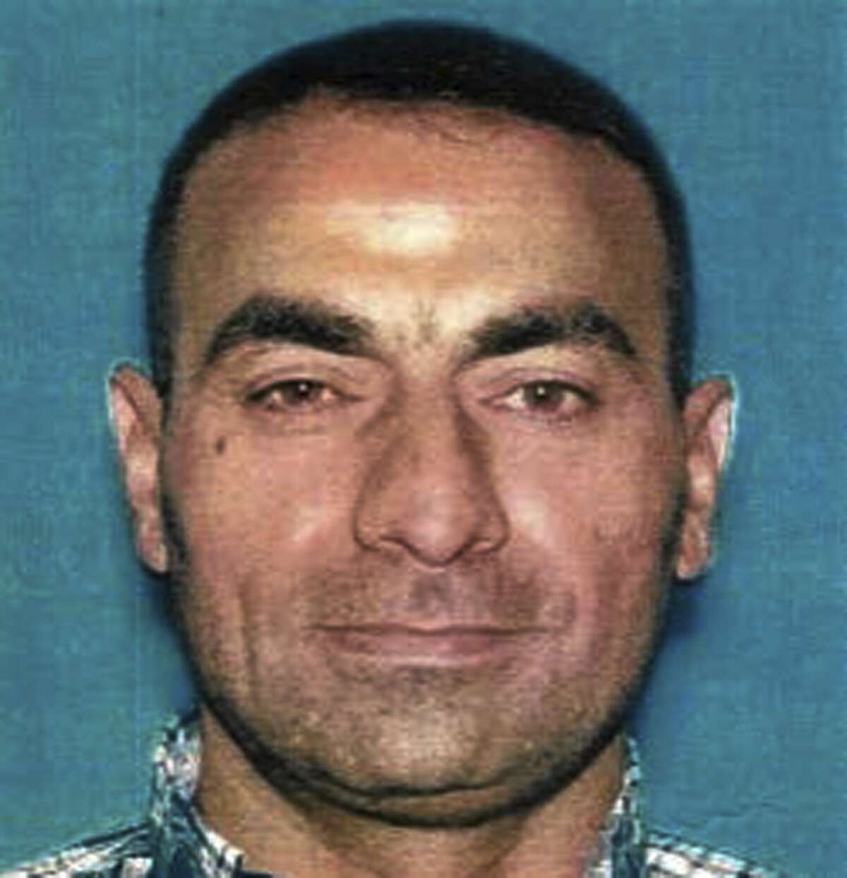 This undated photo provided by the U.S. Attorney's Office shows Omar Abdulsattar Ameen. The refugee from Iraq was arrested Wednesday, Aug. 15, 2018, in Northern California on a warrant alleging that he killed an Iraqi policeman while fighting for the Islamic State organization. (U.S. Attorney's Office via AP)