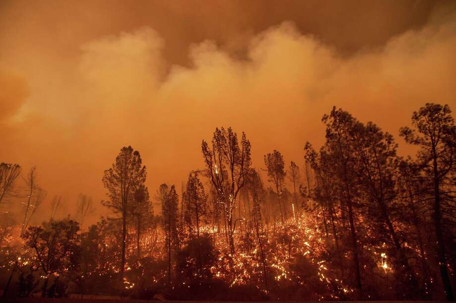 The Carr Fire burns along Highway 299 in Redding, Calif., on Thursday, July 26, 2018.While the state's biggest and most destructive wildfires have been extinguished or largely encircled, firefighters continue to battle blazes in mostly rural areas of Northern California. Photo: Noah Berger / Associated Press / Noah Berger