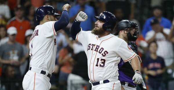 Houston Astros Tyler White celebrates his second home run of the night with  Carlos Correa during the seventh inning of an MLB game at Minute Maid Park d17a699f2aa