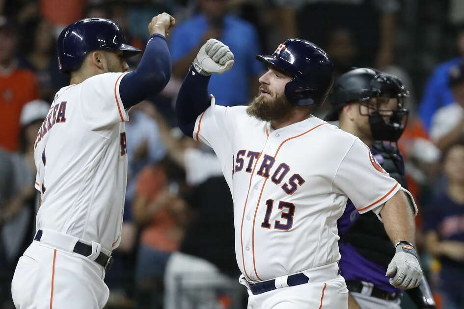 Houston Astros Tyler White celebrates his second home run of the night with Carlos Correa during the seventh inning of an MLB game at Minute Maid Park, Wedneaday, August 15, 2018, in Houston.