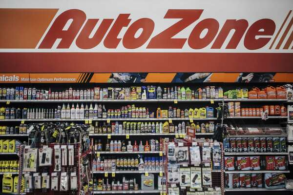 AutoZone signage hangs above automotive products and accessories for sale at a store in Memphis, Tennessee, on May 17, 2018.