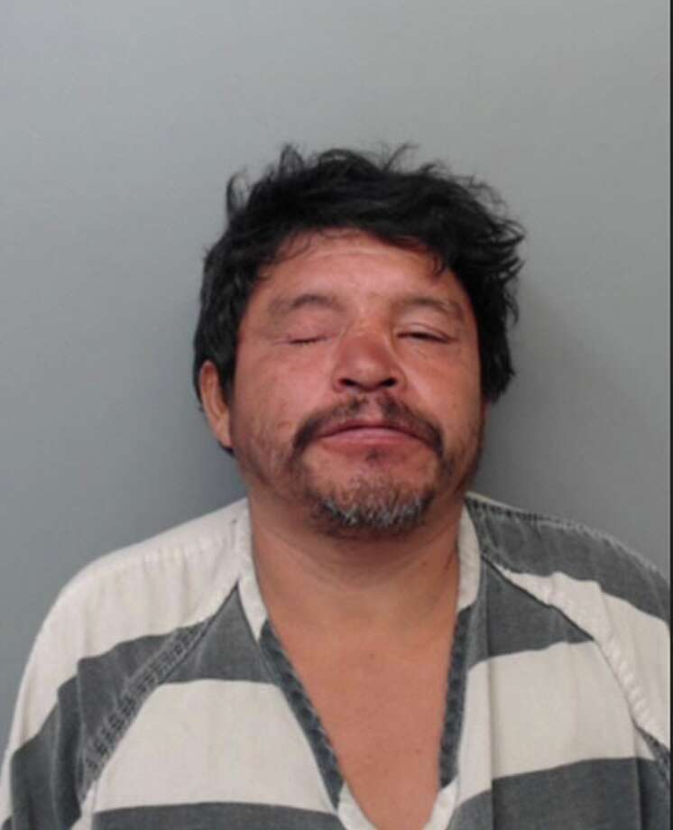 Raul Mendoza, 46, was charged with assault, family violence and aggravated assault with a knife or cutting instrument. Photo: Webb County Sheriff's Office