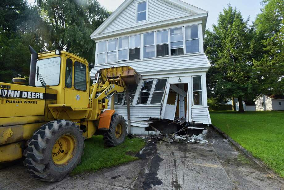 A payloader is used to give support to a home at 37 5th Street on Thursday, Aug. 16, 2018, in Scotia, N.Y. The home was struck by a vehicle.  (Paul Buckowski/Times Union) Photo: Paul Buckowski, Albany Times Union / (Paul Buckowski/Times Union)