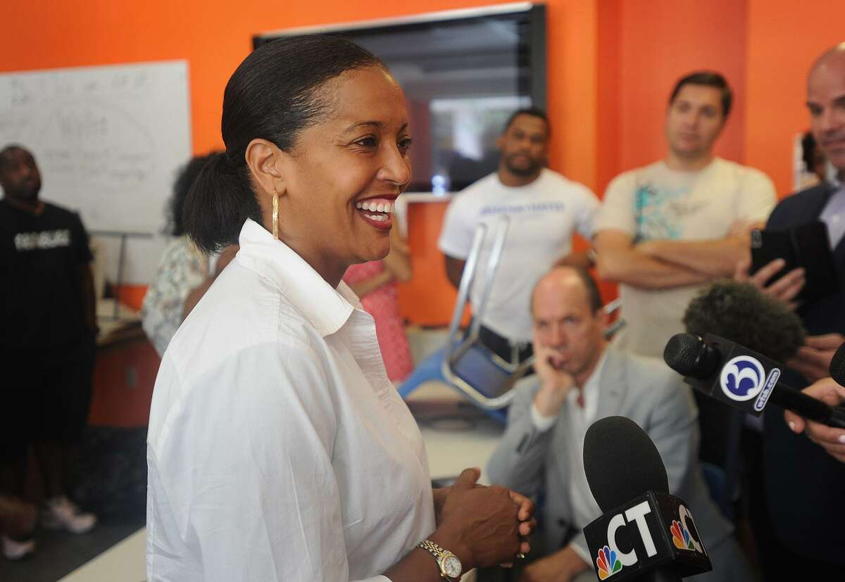 """Jahana Hayes smiles during her interview with the media at her campaign headquarters in Waterbury on Wednesday, the day after her primary for Connecticut's 5th Congressional district. The Democratic Congressional Campaign Committee has added Hayes to its """"Red to Blue"""" program for strong candidates."""