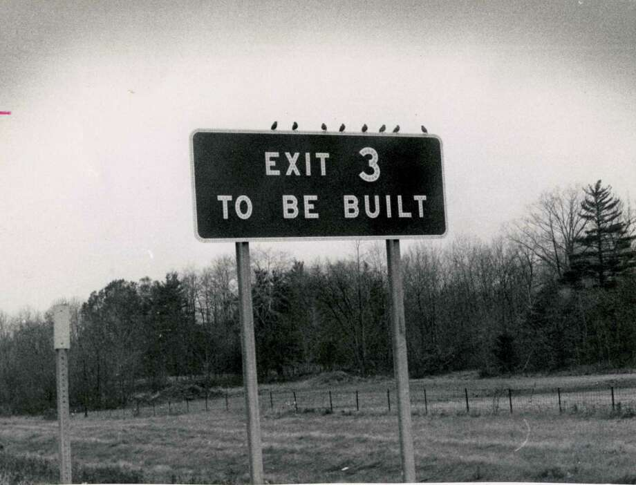 "A construction sign on the Northway in November 1971 announces, ""Exit 3 To Be Built."" More than 40 years later, plans for building the exit are still under discussion. Photo: Times Union Archives"