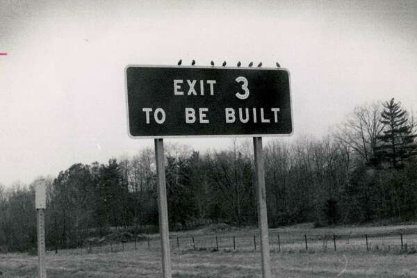 """A construction sign on the Northway in November 1971 announces, """"Exit 3 To Be Built."""" More than 40 years later, plans for building the exit are still under discussion."""