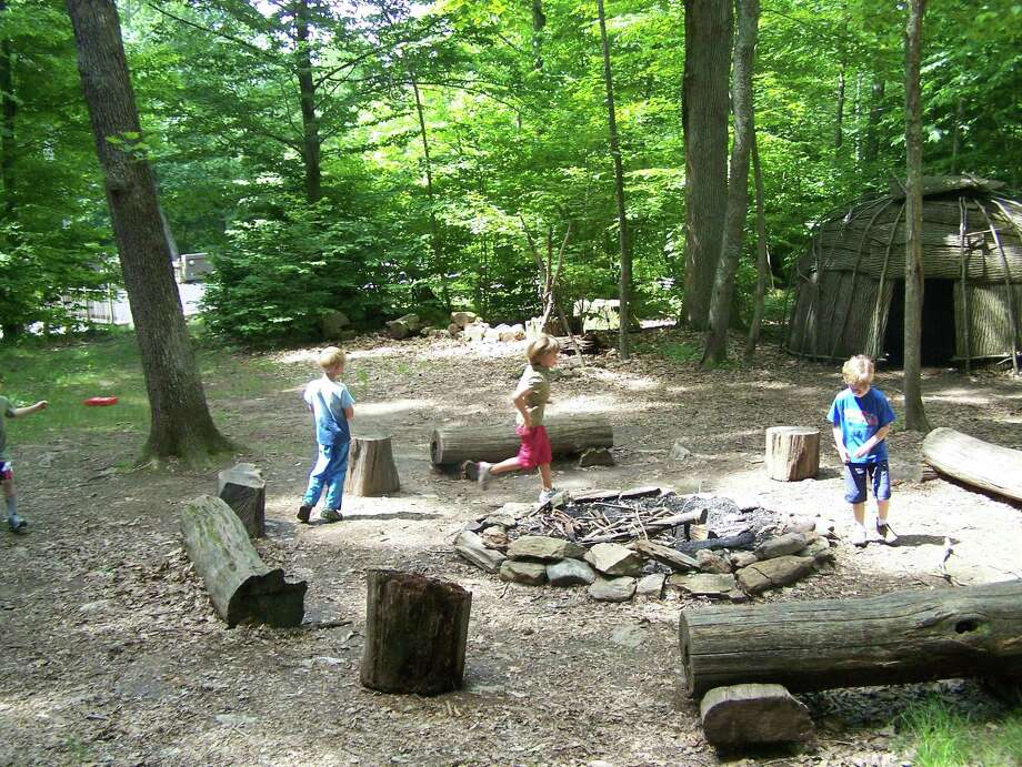Children visit an authentic Algkonian Indian Village in Washington, Conn. Photo: Contributed Photo