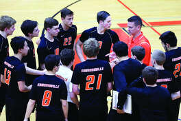 Scott Smith, right, talks to the Edwardsville boys' volleyball junior varsity team during a match. Smtih was named head coach of the varsity team on Monday.