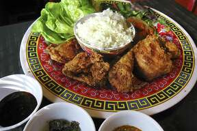 Thai fried chicken with rice, pickles, Bibb lettuce and sauces from Hot Joy.