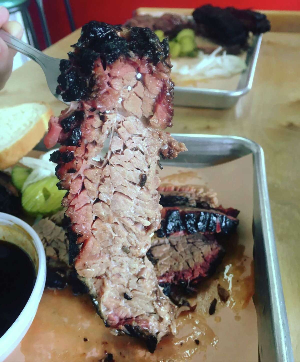 A slice of marbled brisket at Two Sawers BBQ in Floresville.