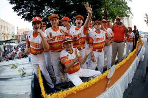 The Southwest Region Champion Little League team from Houston, rides in the Little League Grand Slam Parade in downtown Williamsport, Pa., Wednesday, Aug. 15, 2018. (AP Photo/Gene J. Puskar)