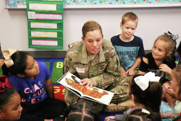 Texas National Guard soldier Carpenter read to students at Richter Elementary in Dayton ISD days after they returned to school. Soldiers had helped deliver school supplies and food to the school to help displaced children who had been forced from their homes.