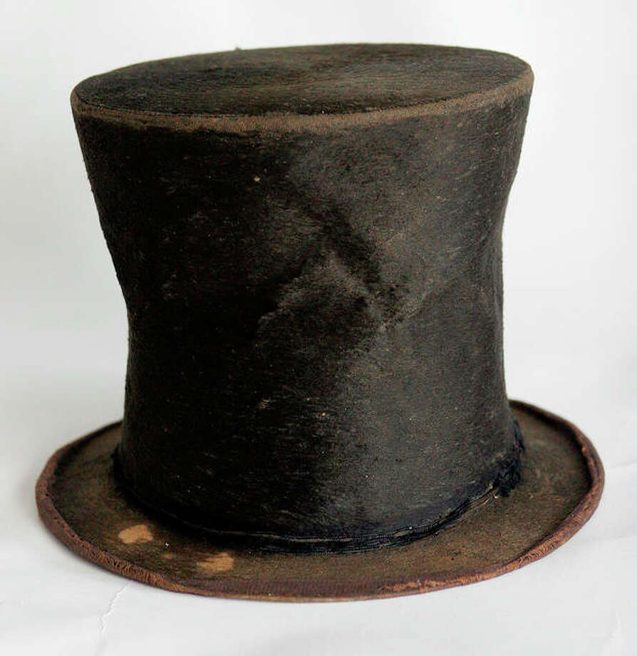 Abraham Lincoln's iconic stovepipe hat at the Abraham Lincoln Presidential Library and Museum in Springfield. The hunt for auctioneers to sell off valuable Lincoln artifacts to pay a $9.7 million debt began Wednesday but the Abraham Lincoln Presidential Library and Museum Foundation cautioned a sale isn't imminent. Photo:       Seth Perlman | AP