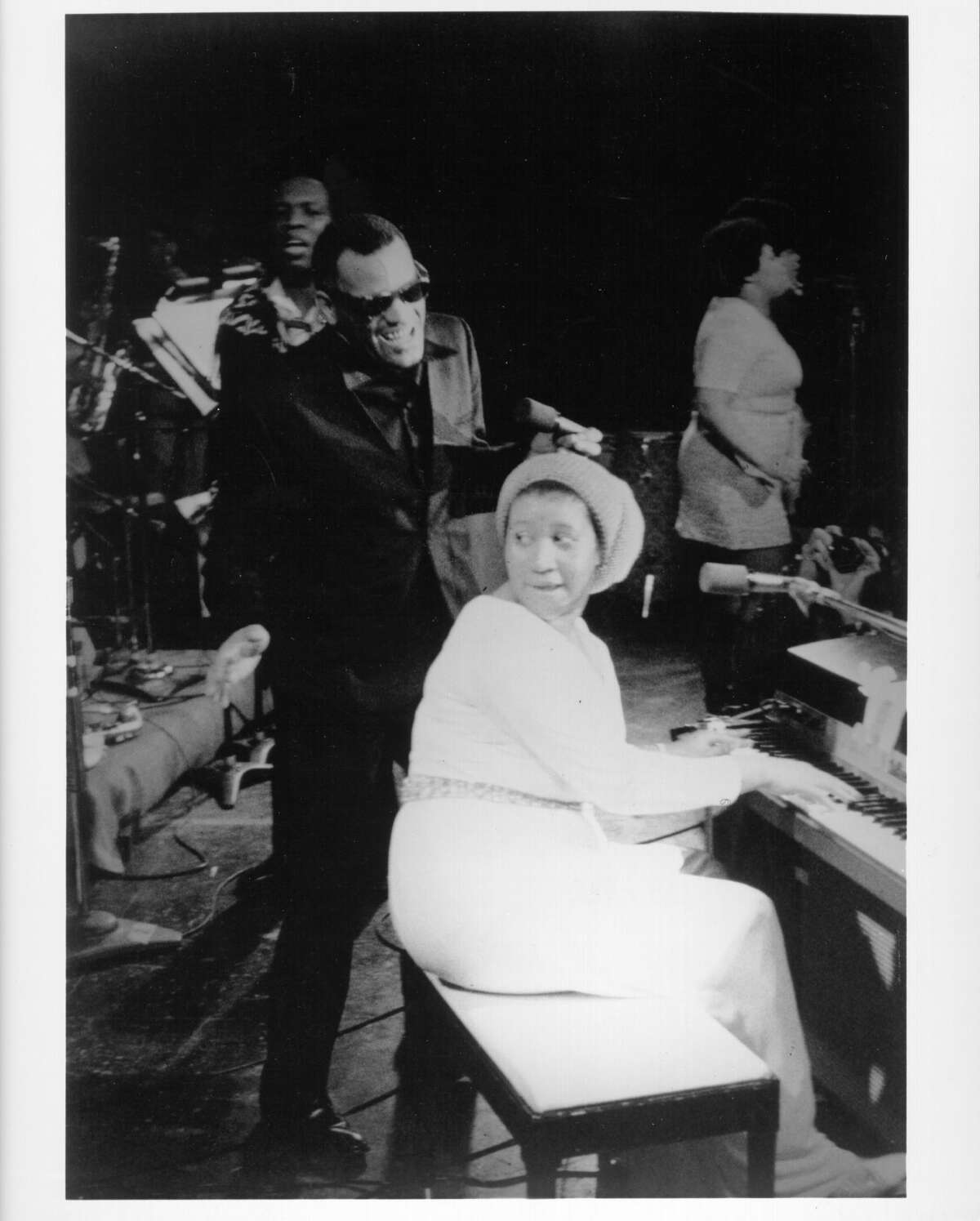 Entertainers and singers Ray Charles and Aretha Franklin perform onstage at the Winterland Ballroom in February 1971 in San Francisco, California. >> See more photos of Aretha through the years >>