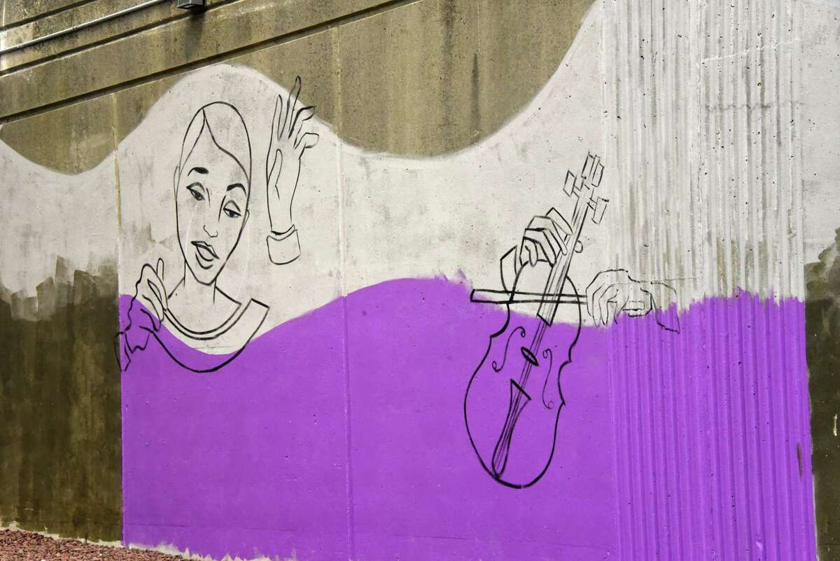 Keep clicking to see photos of street art and murals around the Capital Region. Beginning stage of Liz Zunon's mural