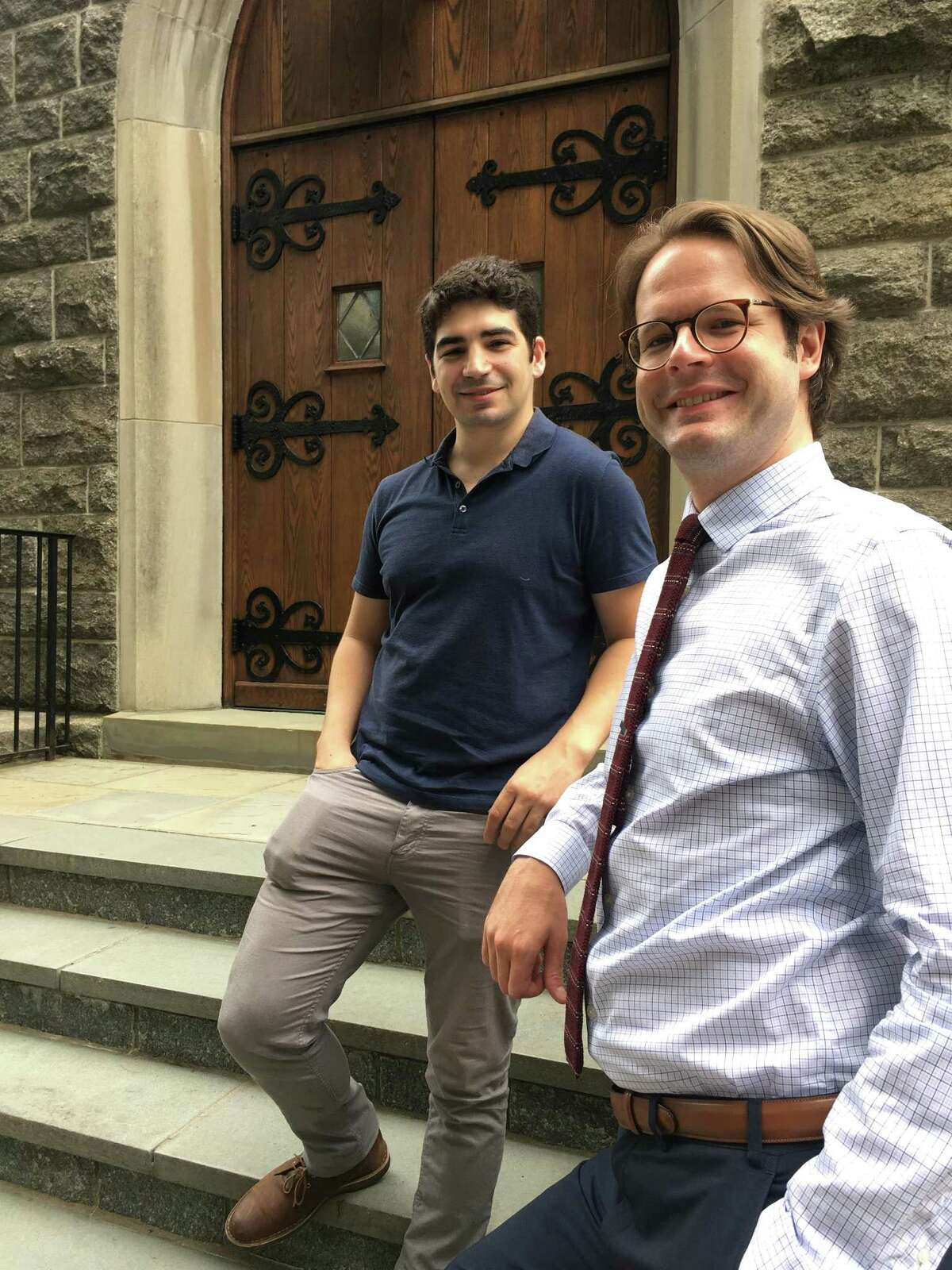 As the Young Artists Philharmonic heads into its 59th season, it will be led by new conductor and music director, Benjamin Grow, right. He stands with the music group's executive director, Greg Robbins, outside the First Congregational Church of Old Greenwich.