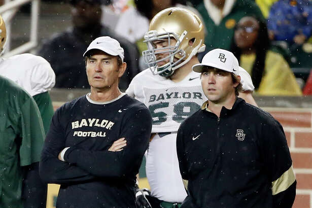 FILE - In this March 20, 2015, file photo, Baylor head coach Art Briles, left, and offensive coordinator Kendal Briles, right, watch a play during an NCAA college football intrasquad scrimmage in Waco, Texas. Briles is handing control to his prized possession, Baylor's bonkers offense, to his only son, Kendal. Similar moves have caused headaches for some of the most accomplished coaches in college football history, a fact that has not gone unnoticed by the elder Briles. (AP Photo/Tony Gutierrez, File)