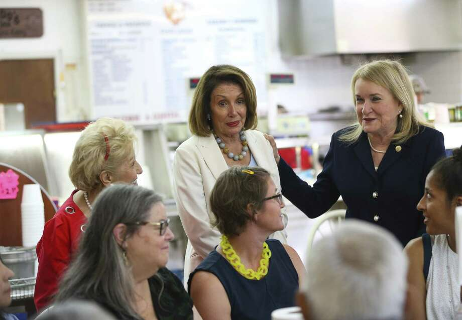 House Democratic leader Nancy Pelosi and congressional candidate Sylvia Garcia talk about issues facing voters this fall with a group of people eating at Gerardo's on Patton Street, Wednesday, Aug. 15, 2018 in Houston. Photo: Mark Mulligan / Staff Photographer / © 2018 Mark Mulligan / Houston Chronicle