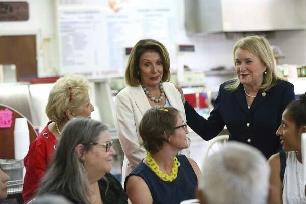 House Democratic leader Nancy Pelosi and congressional candidate Sylvia Garcia talk about issues facing voters this fall with a group of people eating at Gerardo's on Patton Street, Wednesday, Aug. 15, 2018 in Houston.