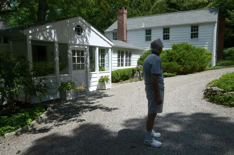 "A French country home named ""Ransacket,"" old Norse for ""to seek a house,"" Tuesday, July 31, 2018, at 6 Topping Lane in Norwalk, Conn. Built in 1930, Ransacket was only home to one couple before Joe Chila and Mary Jane Meehan, the current owners and is on the market listed for $649,000. Photo: Erik Trautmann / Hearst Connecticut Media / Norwalk Hour"