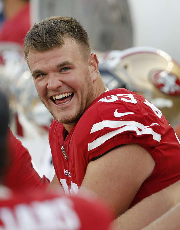San Francisco 49ers offensive tackle Mike McGlinchey sits on the bench against the Dallas Cowboys during the first half of an NFL preseason football game in Santa Clara, Calif., Thursday, Aug. 9, 2018. (AP Photo/Josie Lepe)
