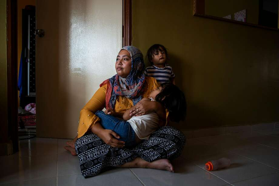 Siti Nor Azila is the second wife of Che Abdul Karim Che Abdul Hamid in Kelantan, Malaysia. Her husband's third wife, an 11-year-old girl, is now under the care of a social welfare agency. Photo: Lauren Decicca / New York Times