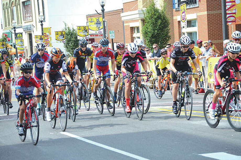 Riders head down North Main Street during a previous Criterium. Photo:       Intelligencer Photo