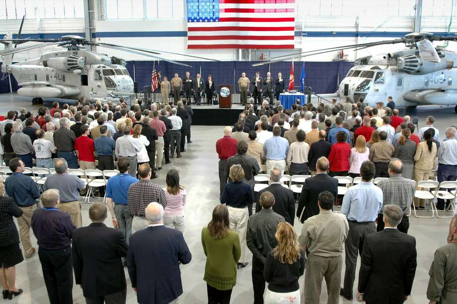 A file photo of a ceremony for the Sikorsky CH-53K helicopter being produced for the Marine Corps by Sikorsky Aircraft. The Stratford manufacturer is among southwestern Connecticut's leaders for job openings with annual compensation at $100,000 or more as it ramps up work on the CH-53K. Photo: File Photo /Ned Gerard / File Photo / Connecticut Post file photo
