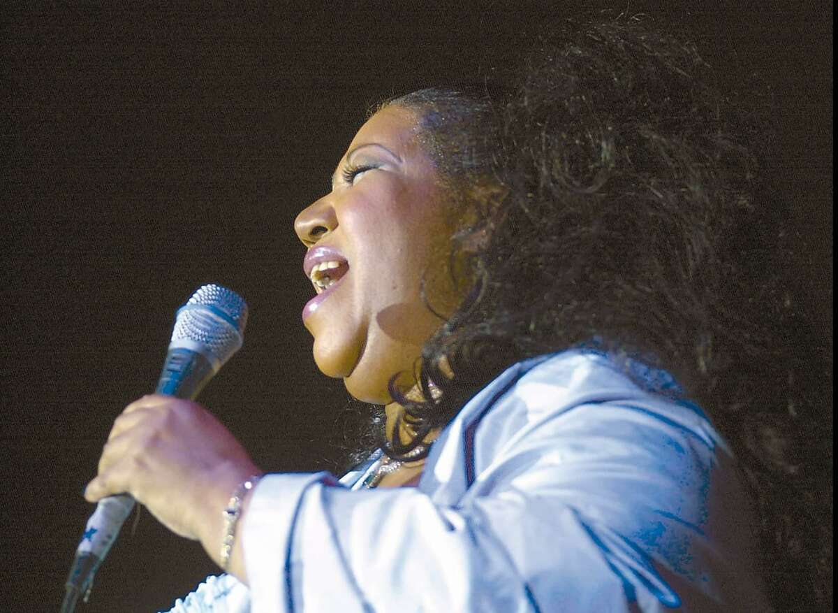 Aretha Franklin performs at Richards clothing store on Greenwich Avenue in October, 2000.