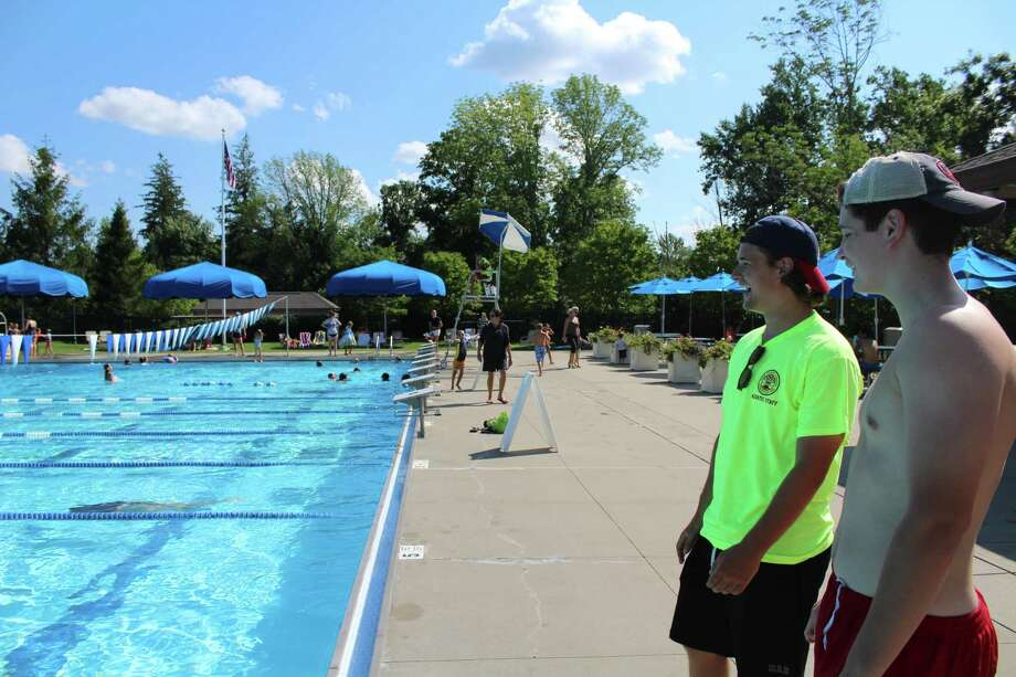 From left, David Noonan and Charlie Marsh are lifeguards at Waveny Pool. Photo: Humberto J. Rocha / Hearst Connecticut Media / New Canaan News