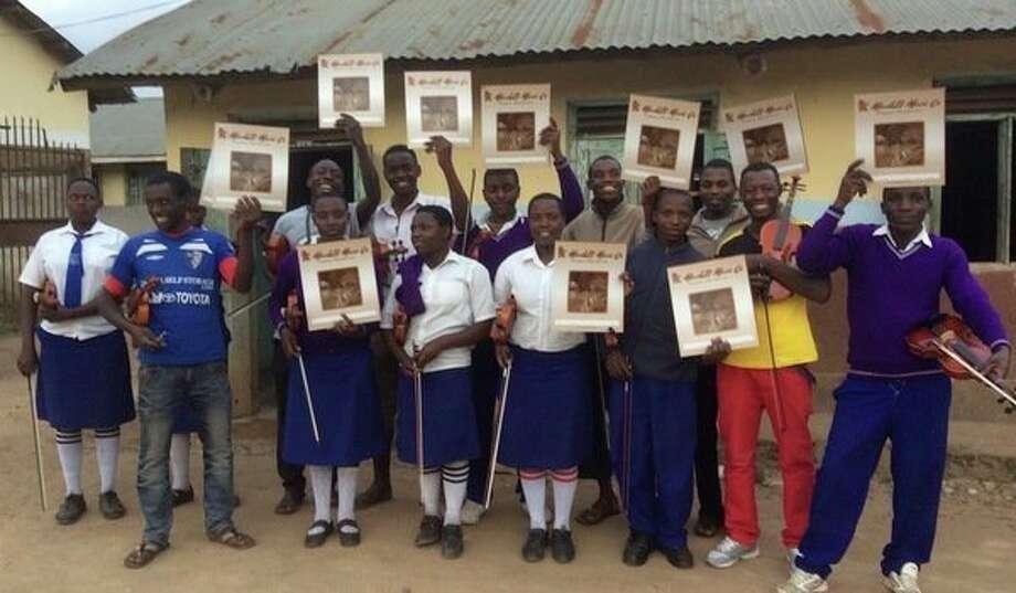 Students in Muko, Uganda receive Marshall Music folders as part of the ACT Uganda MUSIC program. (Photo provided)