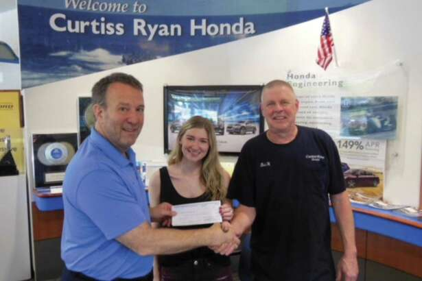 From left, Ed DeMarseilles, COO of Curtiss Ryan Honda, Jacquelyn Hesse and Robert Hesse