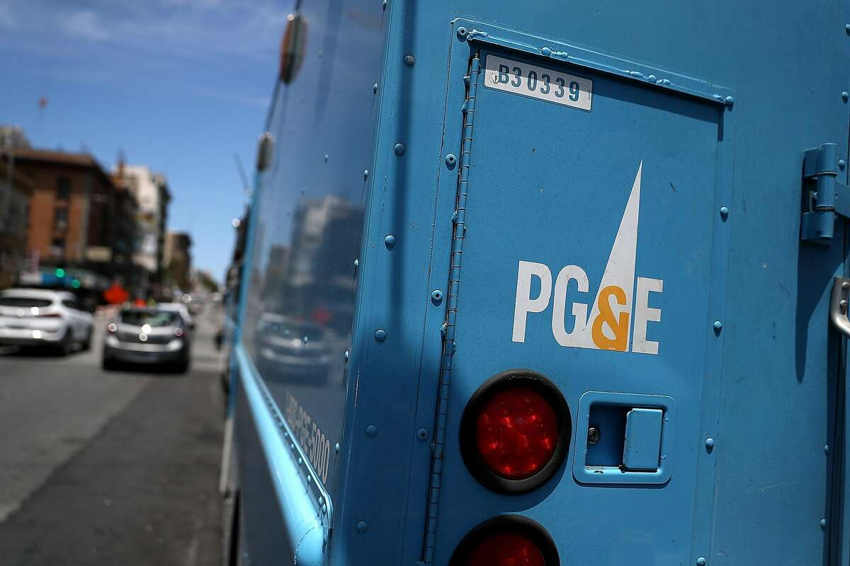 FILE-- A Pacific Gas and Electric (PG&E) truck sits parked on a street on June 18, 2018 in San Francisco. The planned bankruptcy of Pacific Gas & Electric Co. has opened the possibility of San Francisco taking over some or all of the utility's local operations and infrastructure, reinvigorating an enduring debate over whether the city should take on a greater role as a power provider.