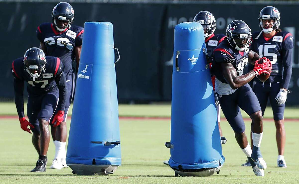 Houston Texans wide receivers Vyncint Smith (17) and Sammie Coates (18) run a drill during a joint practice between the Texans and San Francisco 49ers at the Methodist Training Center on Thursday, Aug. 16, 2018, in Houston.