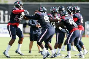 Houston Texans defensive ends Carlos Watkins (91) and Joel Heath (93) runs a drill during a joint practice between the Texans and the San Francisco 49ers at the Methodist Training Center on Thursday, Aug. 16, 2018, in Houston.