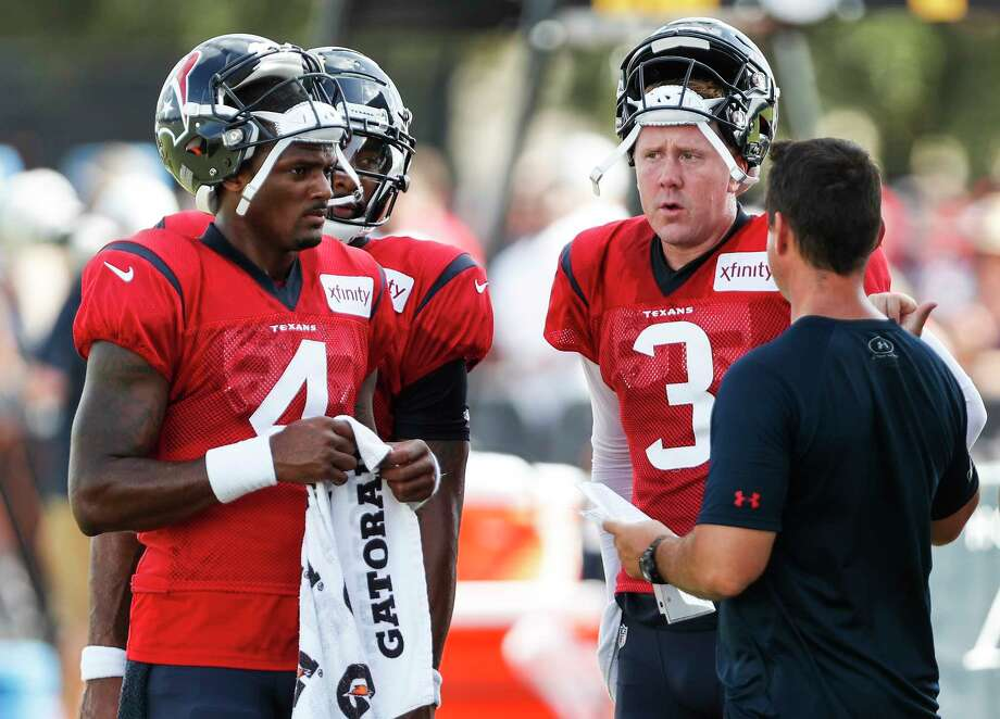 Houston Texans quarterbacks Deshaun Watson (4) and Brandon Weeden (3) listen to quarterbacks coach Sean Ryan during a joint practice between the Texans and the San Francisco 49ers at the Methodist Training Center on Thursday, Aug. 16, 2018, in Houston. Photo: Brett Coomer, Staff Photographer / © 2018 Houston Chronicle