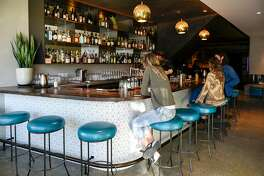 Patrons sit at the bar at the White Cap cocktail bar in San Francisco, Calif., on Saturday January 6, 2018.