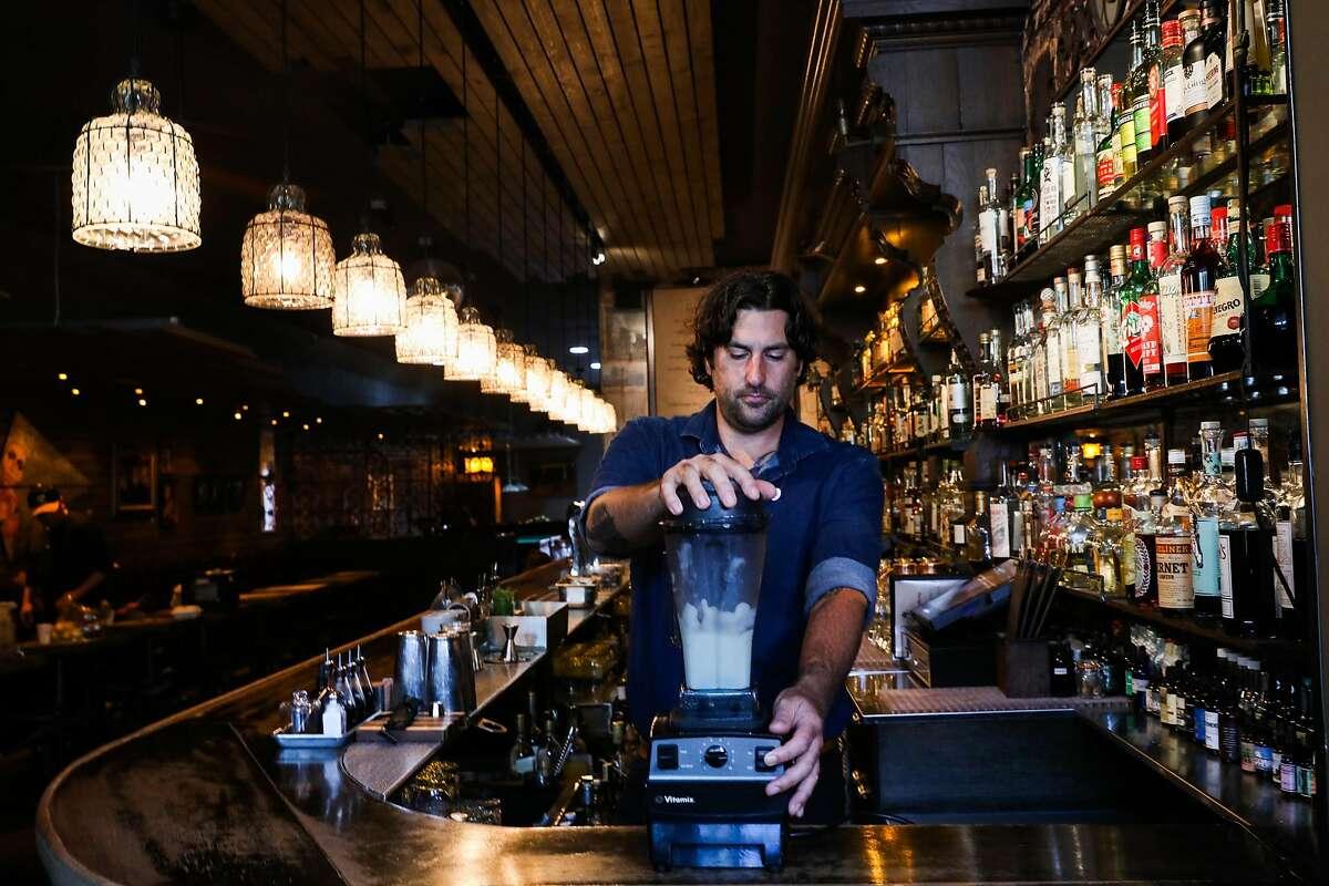 Bar manager Matt Grippo blends the Saturn Returns frozen drink at Blackbird bar in the Castro in San Francisco, California, on Thursday, July 26, 2018.