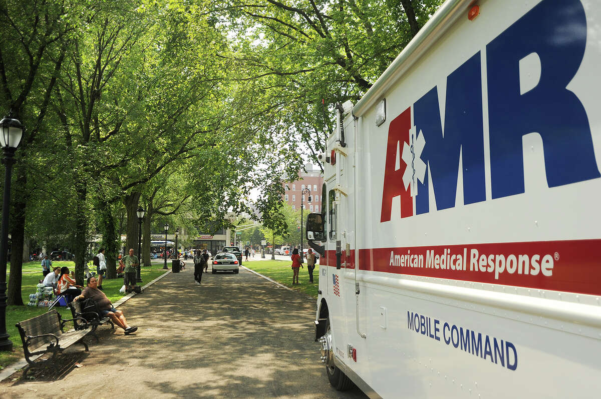 An AMR mobile command truck is parked on the New Haven Green as crews spread out to treat numerous drug overdose victims in New Haven, Conn. on Thursday, August 16, 2018. Distribution of the illegal drug K-2 has resulted in a stream of overdoses, centered mainly on the Green, in the last two days.